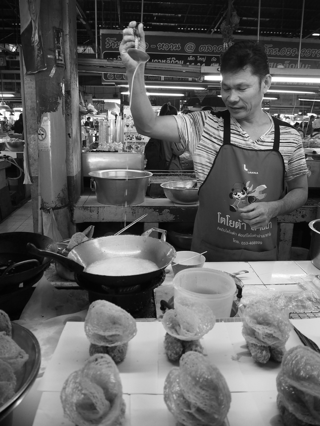 street photography cooking in black white