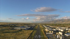 On final approach to Bountiful Skypark near Salt Lake City. (Note the plane landing on the runway.)
