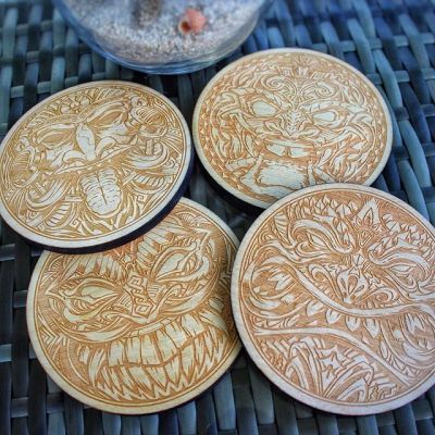 "So happy to release my first set of coasters! Intricite hand-drawn tiki artwork laser-engraved with a real space-laser in wood - 1/4"" thick, 4"" wide. Now available in my shop! http://www.flylanddesigns.com/shop/#coaster #tikiart #tikibar #beachart #tikitotem #surfart #tikiartist #beach #laserengraving"