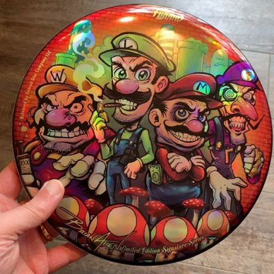 Just got my Bad Mario foil disc golf discs! These are all sold out (thanks everyone!). Will be shipping in the next day or two. If you'd like to sign up to subscribe to each month's disc so you don't miss out on one, contact me. #marioart #nintendofanart #discgolf #frisbeegolf #discraftdiscs #teamdiscraft #detroitdisccompany #disc