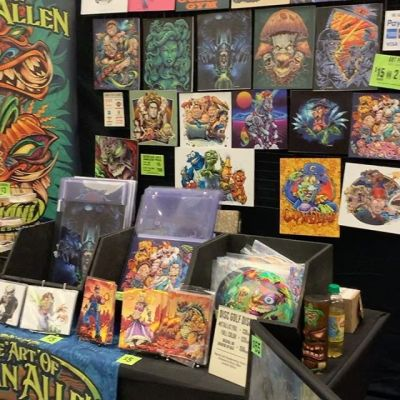 My booth at the Pinball Expo in Chicago - far from home! It's going really well - cool meeting some of the people I've worked with in person for the first time. The Attack From Mars backglass I redesigned seems to be getting some good reactions. I've been eating nothing but subway and slim Jim's for 48 hours. #pinballexpo #pinball #tryingtoohard