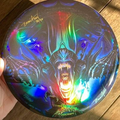 Here's a shot of my monthly Foil Disc Golf Disc with my Alien Queen artwork. Thanks for all the support on these!  Less than 10 of these left. Limited edition of 40. Signed and numbered, let me know if you want one!https://flylanddesigns.com/custom-illustrated-disc#alien #alienqueen #discgolf #frisbeegolf #discraftdiscs #teamdiscraft #discraft #disc