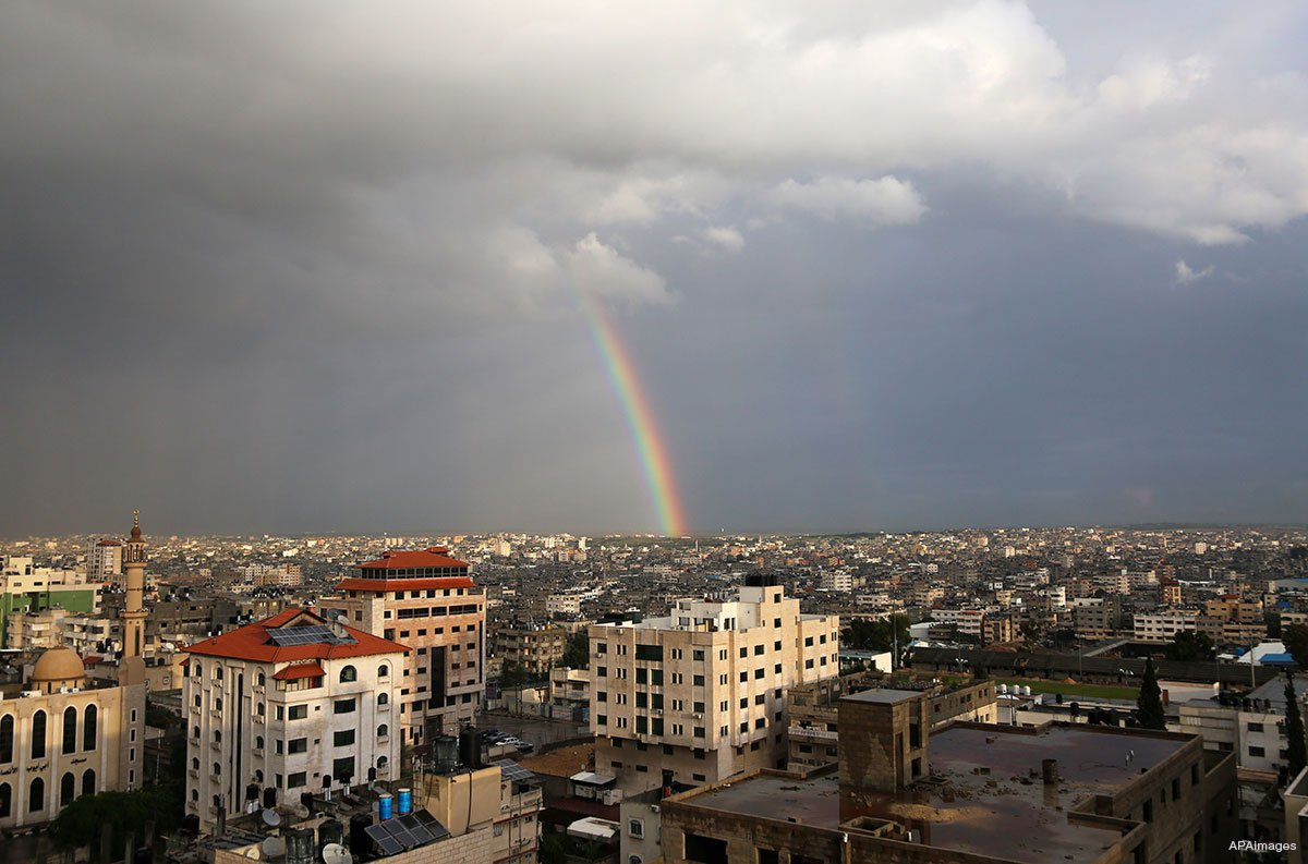 GAZA CITY, GAZA STRIP: A rainbow shines over the city after heavy rains cease.