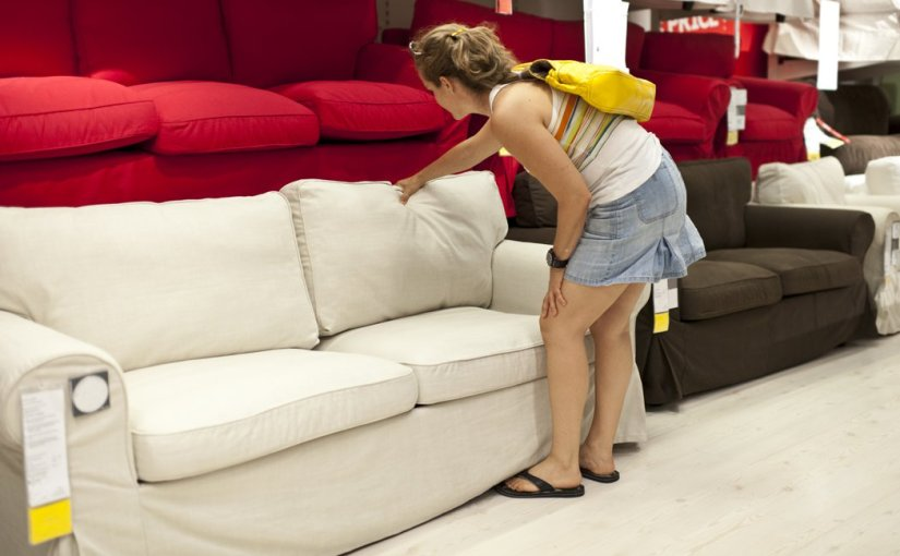 Woman buying a new sofa