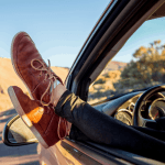 Woman's legs sticking out of car