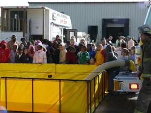 Andalusia Fire Department filling a Fol-Da-Tank for the students from Earl Hanson Elementary School.