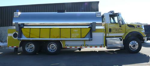 Andalusia fire truck shown with 3500 gallon Fol-Da-Tank. Fol-Da-Tank has heavy duty 30 oz. vinyl floor with grab handles and hinge protectors.