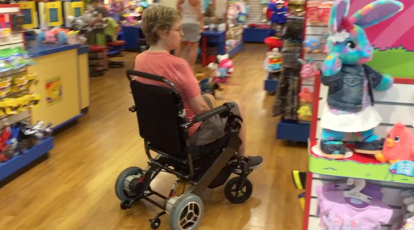 Turning electric wheelchairs