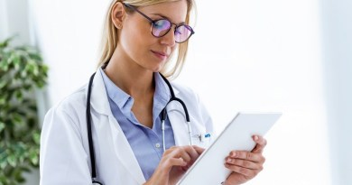 Shot of female doctor using her digital tablet in the consultation.