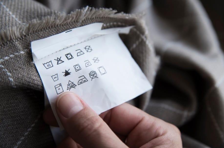 Você sabe decifrar os símbolos das etiquetas das roupas?
