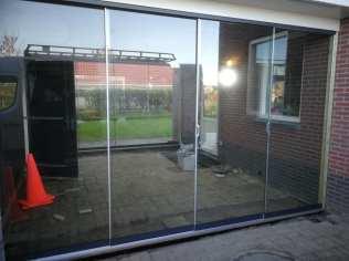 Plaatsen glazen schuifwand - Folkertsma klusbedrijf Friesland