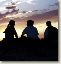 silhouette of young adults