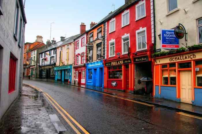 rows of irish pubs in the rain