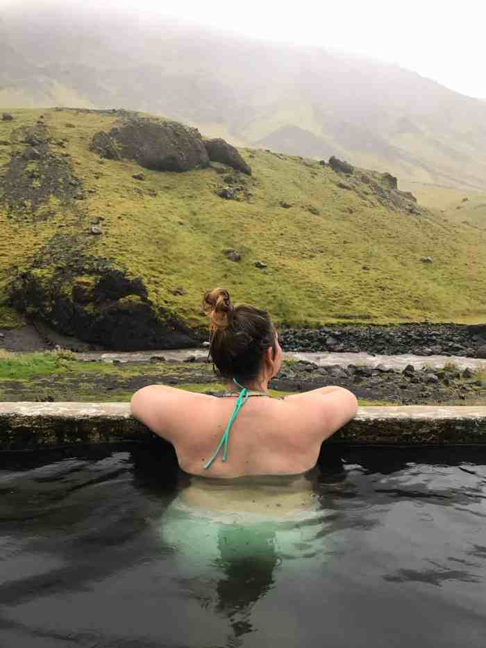 Swimming in Iceland's Seljavallalaug hot springs