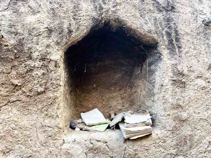 Books at Al Hamra ruins in Oman