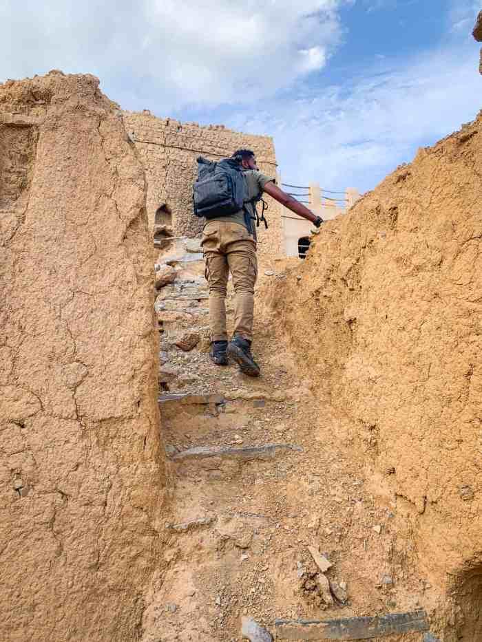 Climbing up stairs in Al Hamra Oman