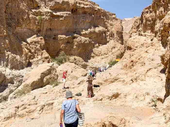 People hiking into Wadi Bani Khalid