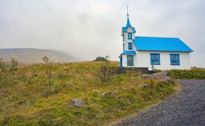 Kirkjubaer Church is a pretty pastel blue church in Iceland