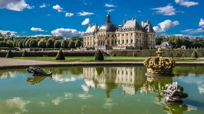 The beautiful castle in France Chateau Vaux le Vicomte is reflected in a pond