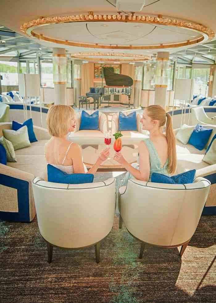drinking cocktails on crystal river cruises Crystal Mahler ship in the palm court