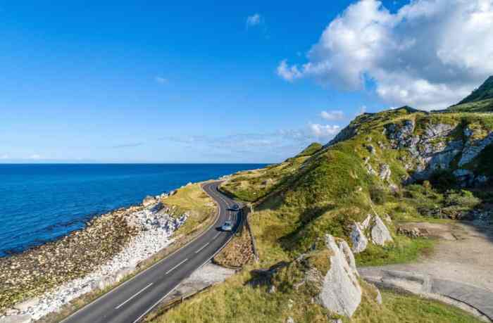 road in ireland with car showing renting a car in ireland