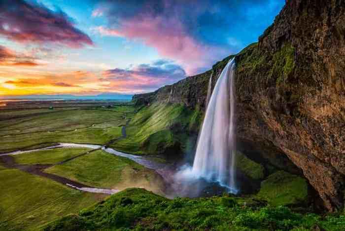 summer at Seljalandsfoss waterfall in South Iceland