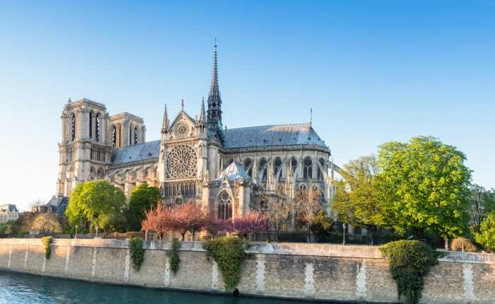 view of Notre Dame Cathedral in spring from across the Seine River