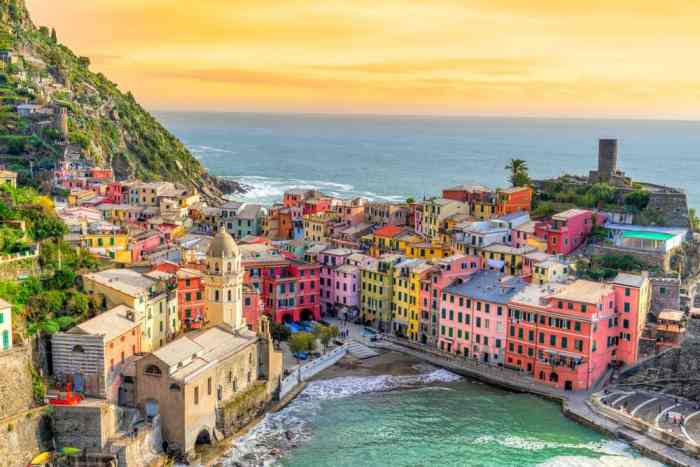 Exactly Where To Stay In Cinque Terre is Vernazza At Sunset!