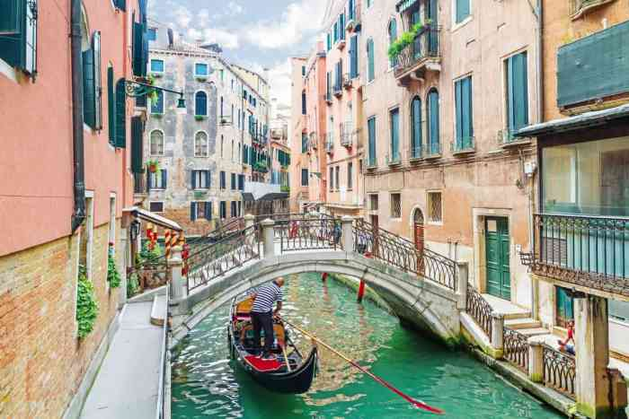 Enjoy a gondola ride on the canals in Venice