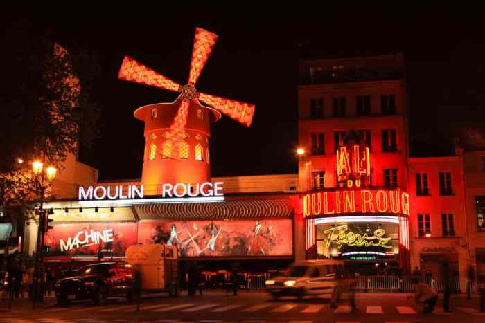 The Moulin Rouge is illuminated red at night
