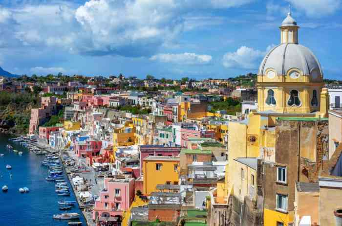 small town in italy on the coast with colorful buildings