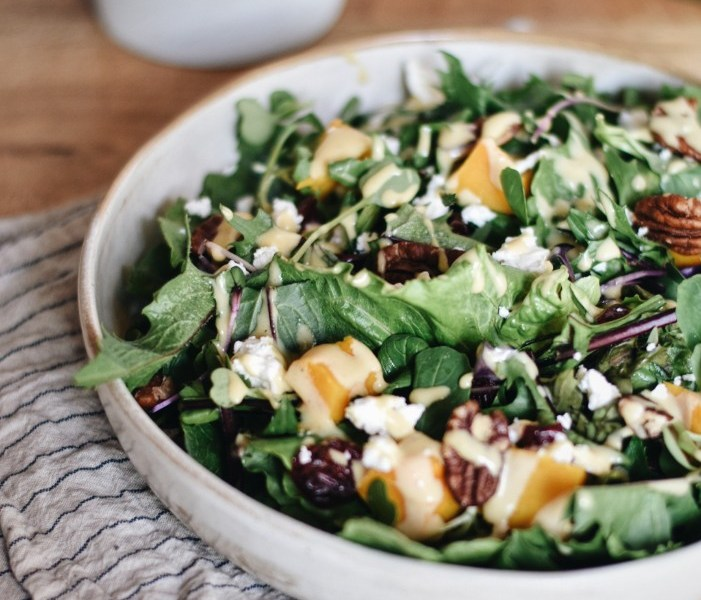 simple autumn salad with pecans, pumpkin and cranberries