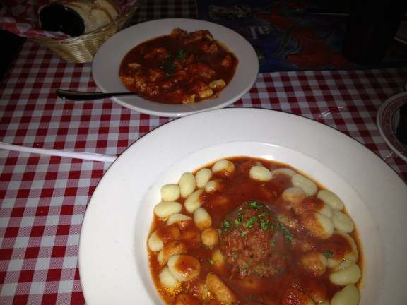 Bowl of gnocchi with a meatball, a small order of tripe with plenty of red sauce