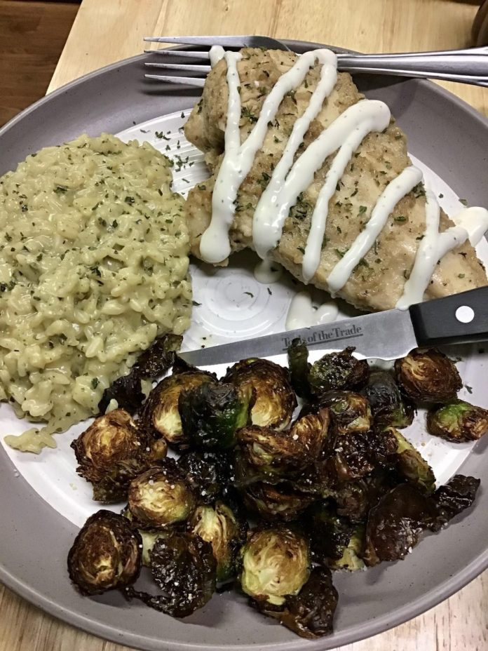 Marinated chicken breast with roasted garlic risotto, and crispy Brussels sprouts!