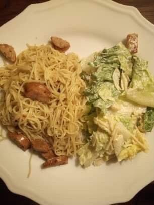 Apple-flavored chicken sausage, angel hair pasta, and Caesar salad