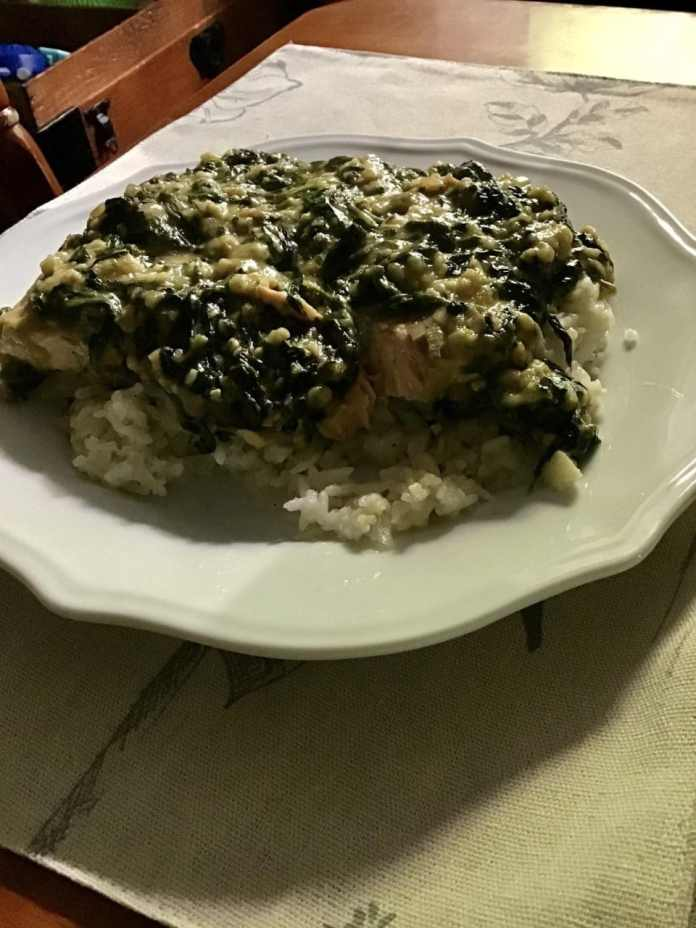 Creamed spinach over salmon filet and jasmine rice