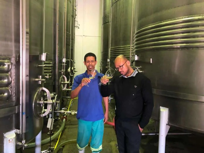 Bothman and Desmond Matthys, cellar assistant at De Wetshof Estate tasting the 2019 Limestone Hill Chardonnay vintage.
