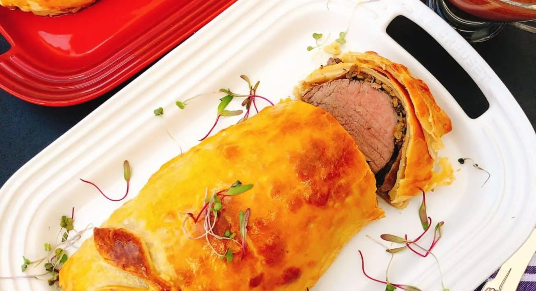 Beef wellington with a red wine jus