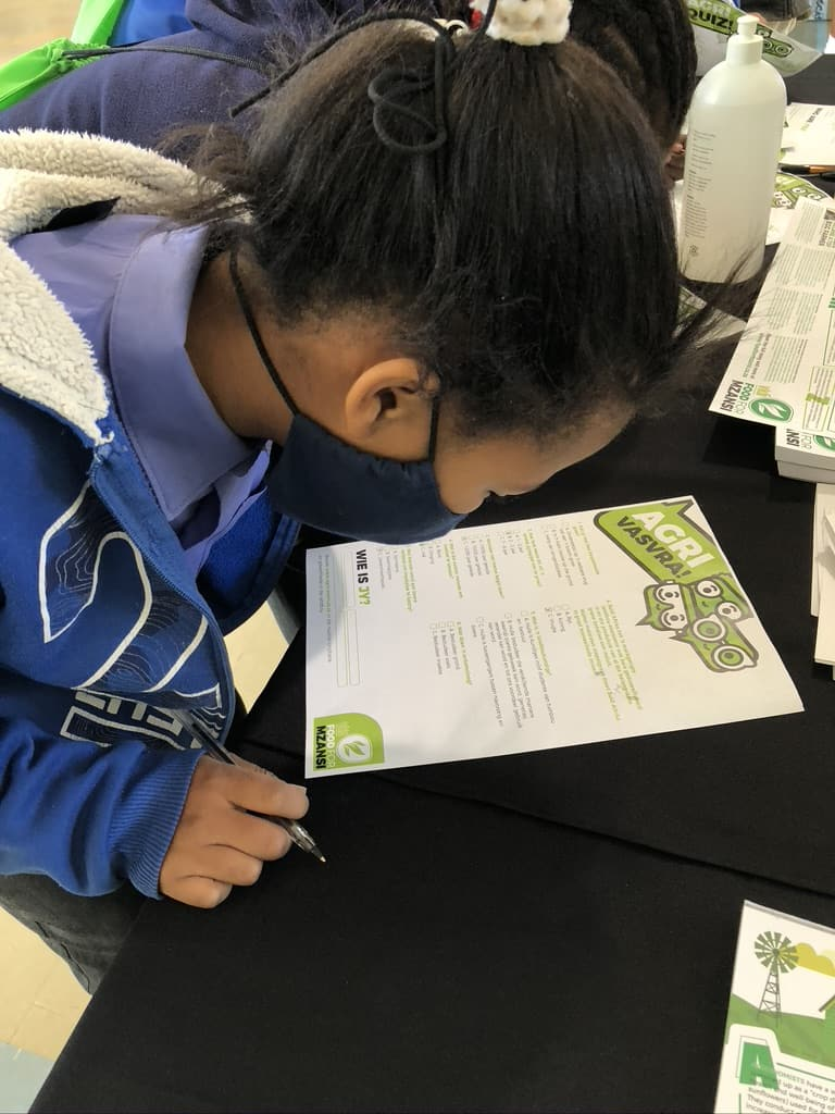 Murraysburg learners visiting Food For Mzansi's exhibition stand answering fun questions to test their agricultural knowledge. Photo: Terri-Ann Brouwers/Food For Mzansi