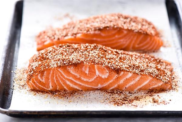 uncooked maple glazed salmon on baking tray