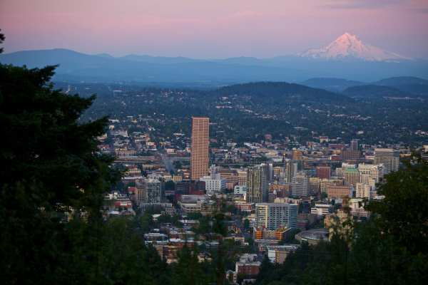 Big Pink and downtown Portland, Oregon with Mount Hood in the distance.