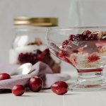 Quinoa in a mason jar topped with cranberry sauce and yogurt