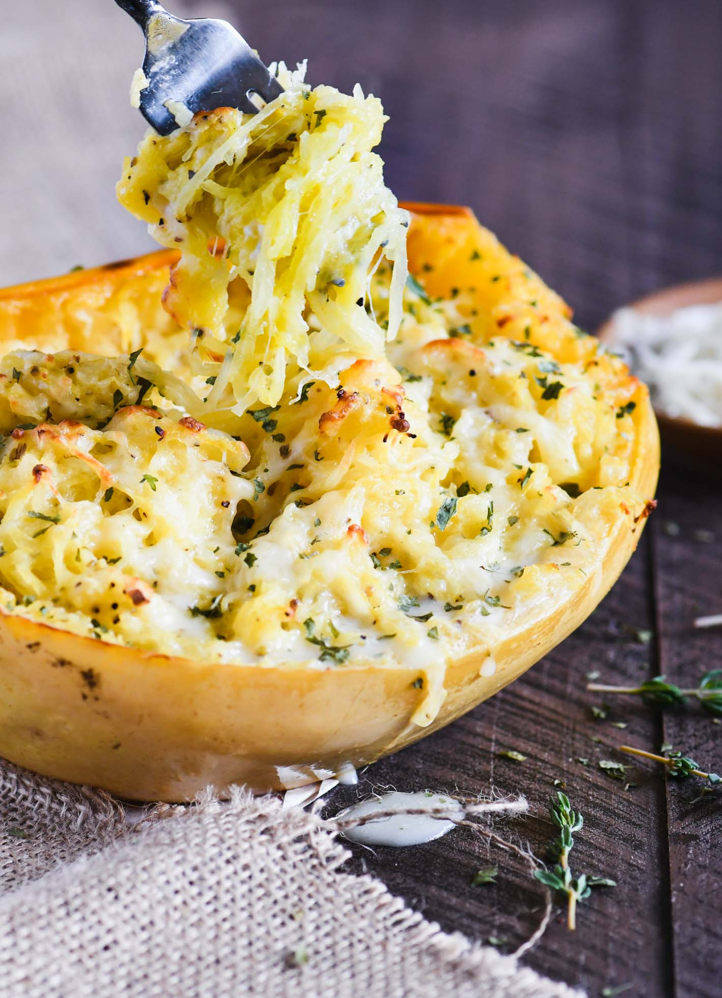 This Cheesy Garlic Spaghetti Squash gets swirled up on a fork just like pasta!