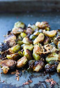 These crispy roasted brussels sprouts topped with parmesan and pomegranate simple syrup will give new meaning to the words side dish!