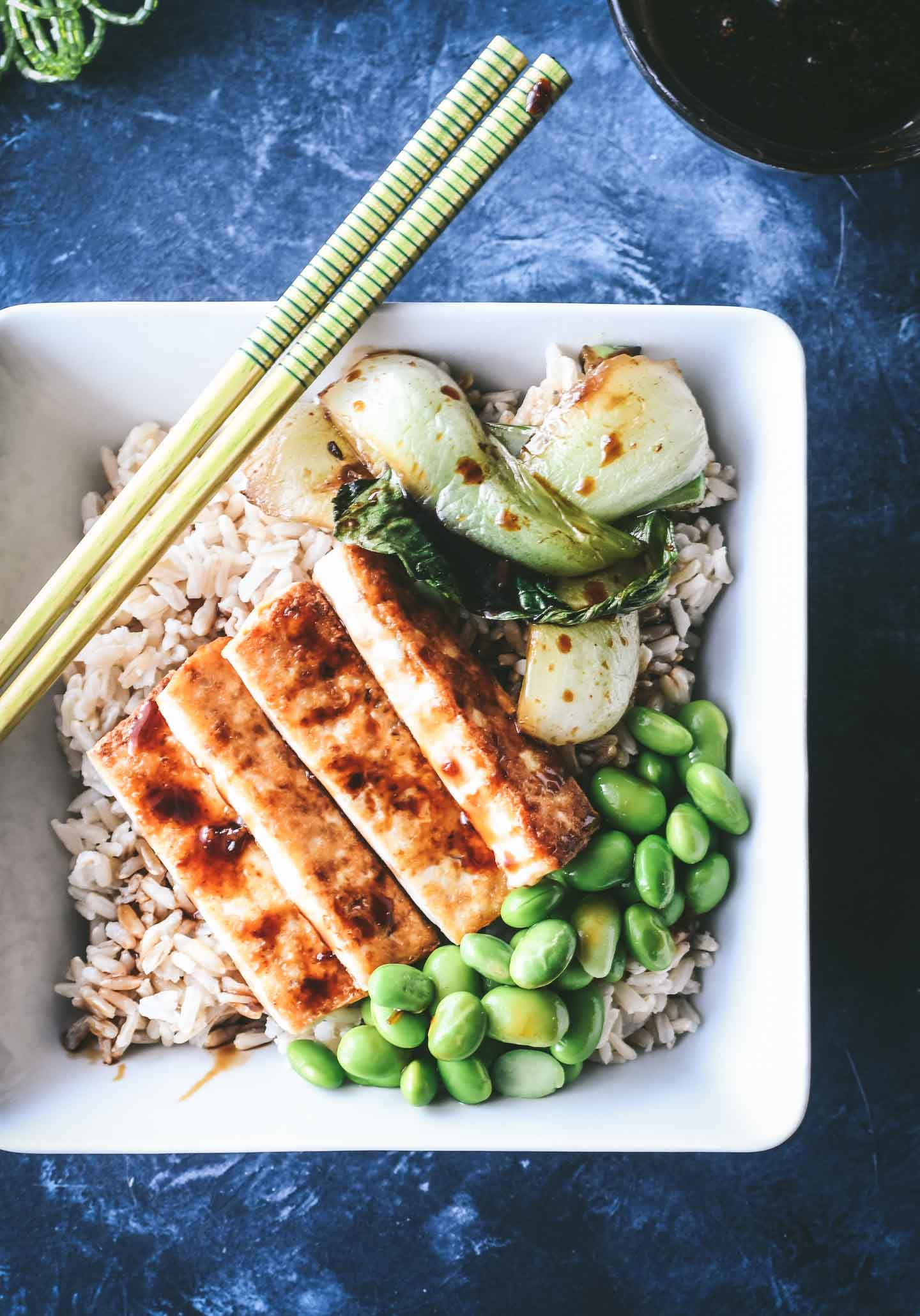 Brown rice topped with crispy tofu, edamame and sautéd bok choy