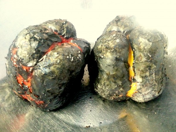 Charred peppers waiting to be covered in a bowl