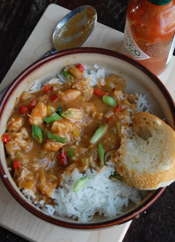 Shrimp Etoufee in a bowl with rice and bread