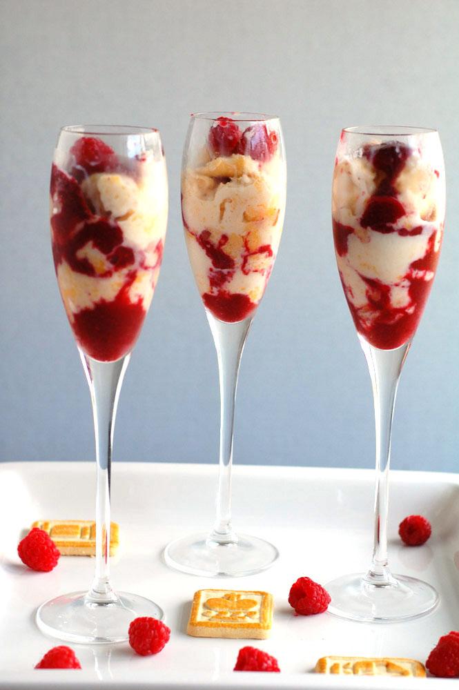 3 peach melba parfaits in champagne flutes