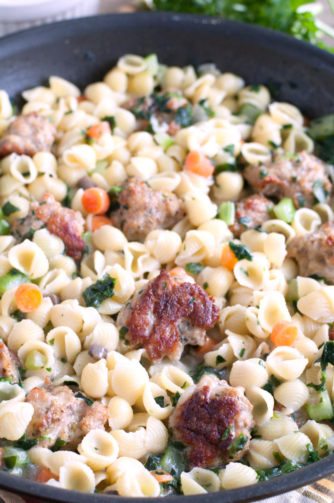 Close-up View of Mini-Shell Pasta, Meatballs and Vegetables in a Pan