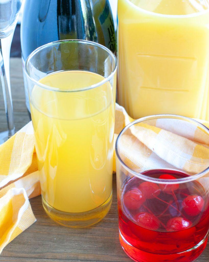 Pineapple juice, orange juice, cherries and sparkling wine